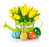 Easter eggs with spring flowers in watering can Stock Image