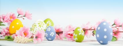 Easter eggs with spring flowers. On wooden table Royalty Free Stock Image