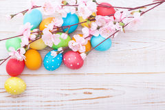 Easter eggs. With spring flowers on wooden table royalty free stock photography