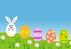 Easter eggs in spring grass. Illustration Royalty Free Stock Photography