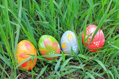 Easter eggs in the spring meadow Stock Photos