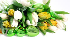 Easter eggs with spring tulips Stock Photo