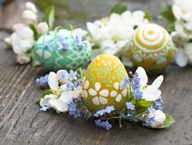 Easter eggs  and  springs flowers Stock Photo
