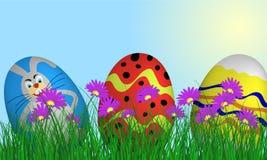 Easter Eggs on Springtime Meadow Stock Photo
