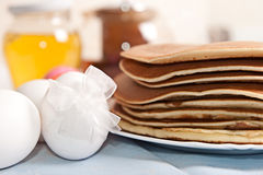 Easter eggs and pancakes Royalty Free Stock Photos