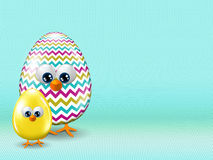 Easter eggs staying on turquoise background with place for text Royalty Free Stock Image