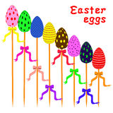 Easter eggs on sticks arranged as ladder Royalty Free Stock Image