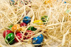 Easter eggs in straw. Nest Stock Photos