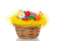 Easter eggs in straw basket Royalty Free Stock Photos