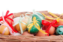 Easter eggs in a straw basket Royalty Free Stock Photography