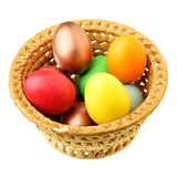 Easter eggs in straw bowl Royalty Free Stock Image