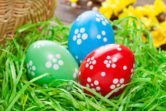 Easter eggs in straw nest Stock Photography