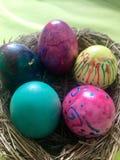 Easter Eggs in straw nest Stock Photo