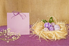 Easter eggs in a straw nest stock photos