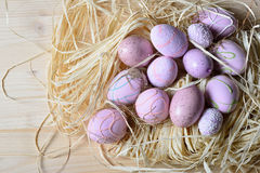 Easter eggs in a straw nest. On a wooden table Stock Image