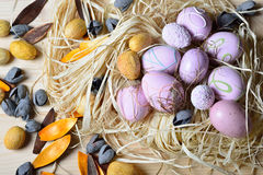 Easter eggs in a straw nest. On a wooden table Stock Photography
