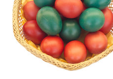 Easter eggs in straw plate isolated Royalty Free Stock Images