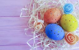 Easter eggs in straw, wooden pink springtime festive april, card. Easter eggs in straw wooden pink april card springtime festive Royalty Free Stock Images