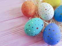Easter eggs in straw, wooden pink space springtime festive april, card. Easter eggs in straw wooden pink april card springtime festive space Royalty Free Stock Photography