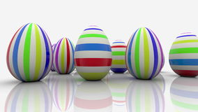 Easter eggs with stripes on white. In backgrounds stock video footage