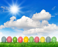 Easter eggs sunny blue sky. Holidays background Stock Photography
