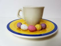 Easter eggs sweet eggs coffee tea saucer Royalty Free Stock Photo