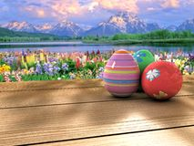 Easter eggs on a table. Colorful Easter eggs on a table near to a lake and a mountain Stock Photography