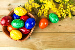 Easter eggs on the table. Easter eggs and mimosa on the table Stock Photography
