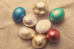Easter eggs on table. Holiday background. Stock Photos