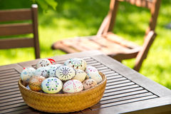 Easter eggs on the table. Painted Easter eggs in the garden royalty free stock images
