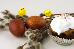 Easter eggs and tasty cupcakes with cream Royalty Free Stock Photo