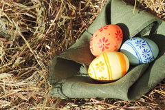 Easter eggs and textile on hay Royalty Free Stock Photo