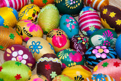 Easter eggs texture. Handmade easter eggs on wooden plate Royalty Free Stock Image