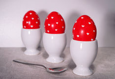 Easter eggs. Three colored eggs in the small cup Royalty Free Stock Photo