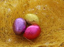 Easter eggs, three colorful shiny chocolate eggs Royalty Free Stock Photo