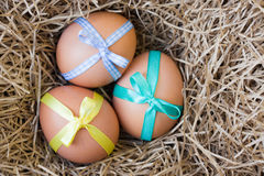 Easter eggs tied with ribbon Royalty Free Stock Photography