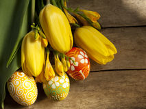 Easter eggs and tilips. Easter eggs hand-painted and and tilips yellow Stock Images