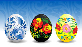 Easter eggs with traditional russian ornament. Three easter eggs with traditional russian ornaments: gzhel and hohloma Stock Photos