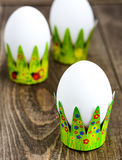 Easter eggs on trays tsvenyh. On the wooden table royalty free stock image