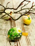 Easter eggs and tree branch on old wooden Stock Photography