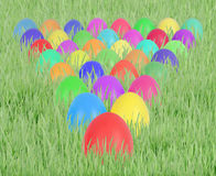 Easter eggs in triangle. On green grass Stock Photography