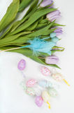 Easter eggs and tulip bouquet Royalty Free Stock Photography
