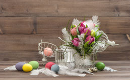 Easter eggs tulip flowers Vintage decoration wooden background Royalty Free Stock Image