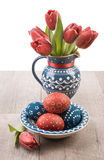 Easter eggs and tulips Stock Photos