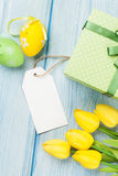 Easter eggs, tulips and blank tag Royalty Free Stock Photos