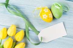 Easter eggs, tulips and blank tag Stock Photography