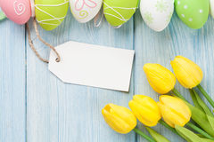 Easter eggs, tulips and blank tag Stock Photos