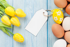 Easter eggs, tulips and blank tag Stock Images