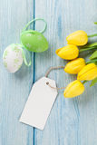 Easter eggs, tulips and blank tag Royalty Free Stock Photo