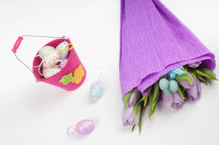 Easter eggs with tulips and bucket Royalty Free Stock Images